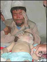 A bereaved Afghan father weeps over the body of his son, killed by USA ?liberators?. Where will this man go for justice?