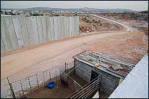 The wall, three times as long - in places twice as high - as the Berlin Wall, will imprison hundreds of thousands of Palestinians in three separate enclosures.