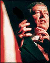 Attourney General, Christian capitalist, John Ashcroft puts his words of hate into a gesture.