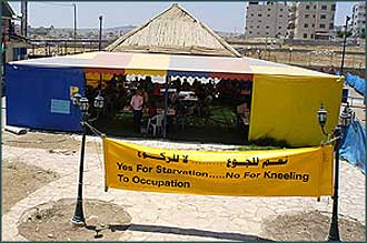 The tent, near a section of the barrier being built on the edge of East Jerusalem, where the hunger strike is being held.