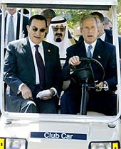 Presidents Bush and Mubarak, and King Fahd enjoy a game of golf while their respective countries plunge headlong into a fascist nightmare.
