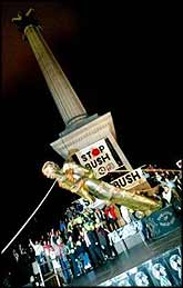 A statue of George W Bush is toppled in London's Trafalgar Square, in a renactment of the destruction of Saddam Hussein's statue in Baghdad, as part of demonstrations against Bush's visit to London.