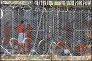 Guantanamo prisoners are routinely held in cages that would be considered inhumane if applied to animals in a zoo.