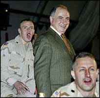 There to welcome George W Bush, on his two-hour visit to Baghdad Airport, was the joker/trickster/puppet President of the Iraqi Governing Council, Ahmed Chalabi.