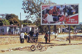 Enjoy your world! Africans wait by the roadside, in hope of exploitation in the form of a day's work.