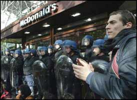 French riot police guard a McDonald's 'restaurant' during a demonstration by anti-globalisation activists on the Champs-Elysees in Paris.