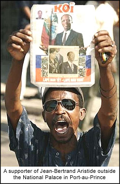 A supporter of Jean-Bertrand Aristide outside the National Palace in Port-au-Prince