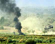 A USA helicopter burns after an RPG attack - one soldier was injured in this attack.