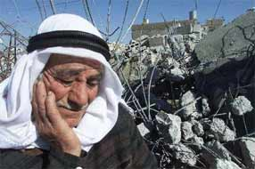 An elderly Palestinian ponders the prospects for his future in front of the remains of his house, after it was demolished by Israeli occupiers.