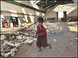 Homeless Iraqi children use the relative safety of a warehouse, and all of their imagination, to pretend that the world really is a place for them to grow up in.