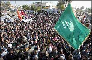 Iraqis demonstrate in front of the provincial governor's office in Hillah, south of Baghdad, calling for a free election to choose a new governor.