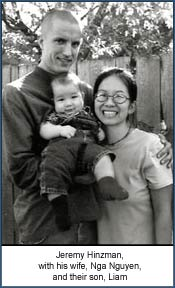 Jeremy Hinzman, with his wife, Nga Nguyen, and their son, Liam.