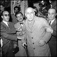 Mossadeq at the trial after the coup, at which he was sentenced by the Shah?s courts to three years, and prevented from entering politics again.