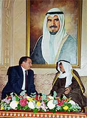 President Mubarak and Kuwait's Sheik Jaber sit in indolent luxury underneath a huge portrait of the Kuwaiti monarch.