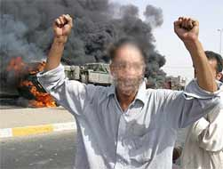 A resident of Baghdad (disguised) jumps for joy as another strike is made by resistance fighters against the USA occupiers.