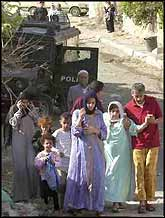 Destitute Nation. A Palestinian family in Jenin, pictured moments before the Israeli occupation forces blew up their home.