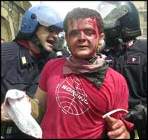This is just one instance of many acts of police brutality that took place at the Genoa demonstrations against capitalist globalisation in 2001.