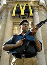 Spreading democracy, ?war on terror? style. A policeman guards a McDonalds restaurant inside the Pakistani dictatorship.