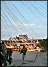 Israel rains down white phosphorus on a Gaza residential district.